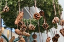 04 a simple evergreen wreath with hanging pine cones