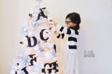 04 a small white tree decorated with black letters will help your kids learn them