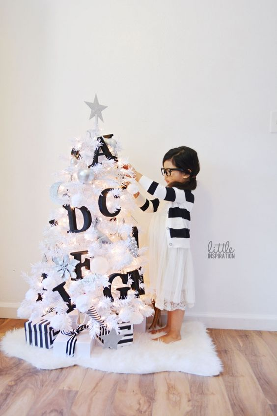 a small white tree decorated with black letters will help your kids learn them - Black And White Christmas Tree Decorations