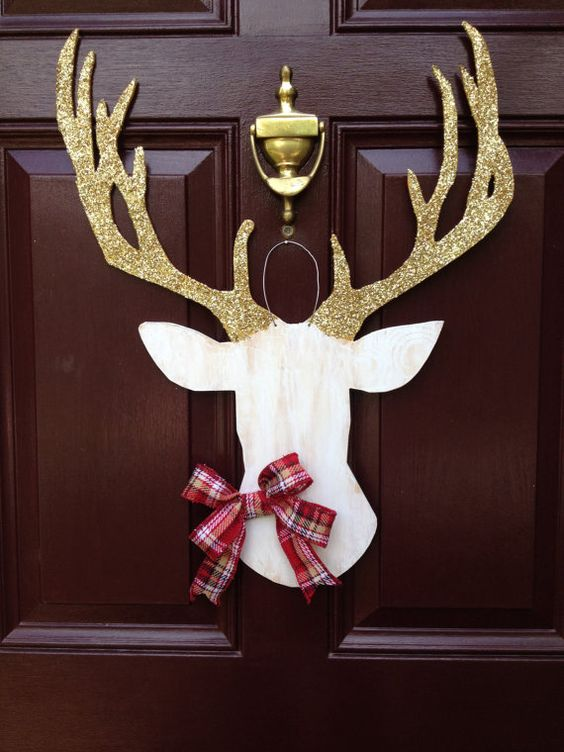 deer silhouette door hanger with glitter antlers and a plaid bow