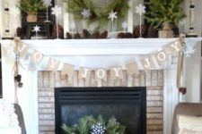 04 organic decorated mantel with pinecones, evergreens and burlap is ideal if you want something rustic