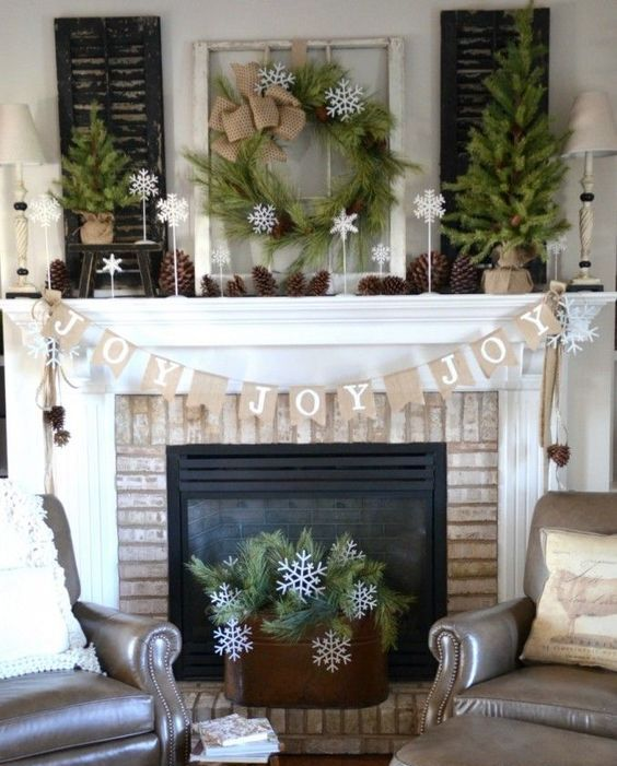 organic decorated mantel with pinecones, evergreens and burlap is ideal if you want something rustic