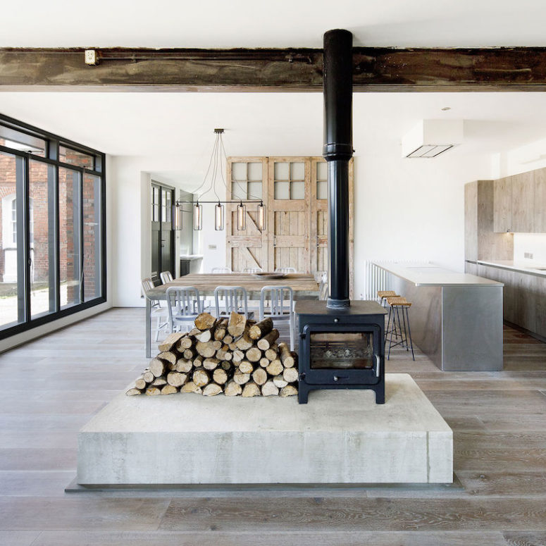 A hearth in the center divides the space into zones