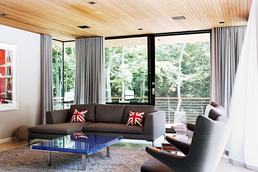 Another sitting room is decorated in dove grey and blue, with extensize glazings that offer calming views