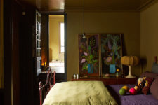 05 The master bedroom is done in ocher and spruced up with bold artworks from the owners' collection
