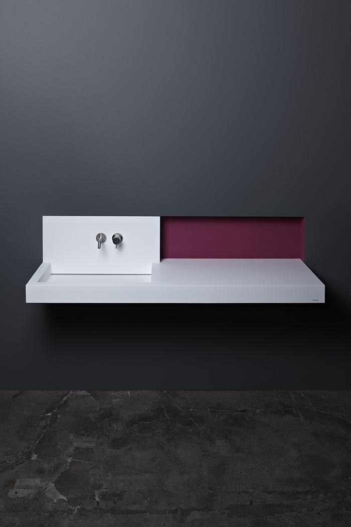 The piece is made of white Corian, and there's a countertop for comfort