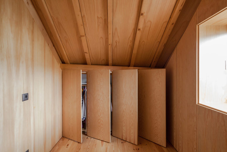 This smart closet solution was installed in a small attic space, which is very useful and practical idea