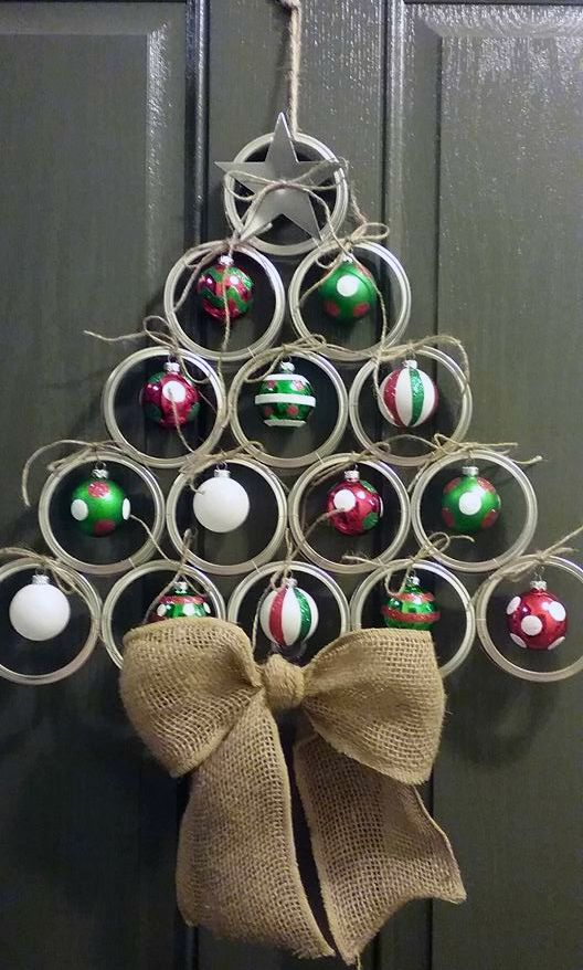 mason jar lid door hanger with ornaments and a burlap bow