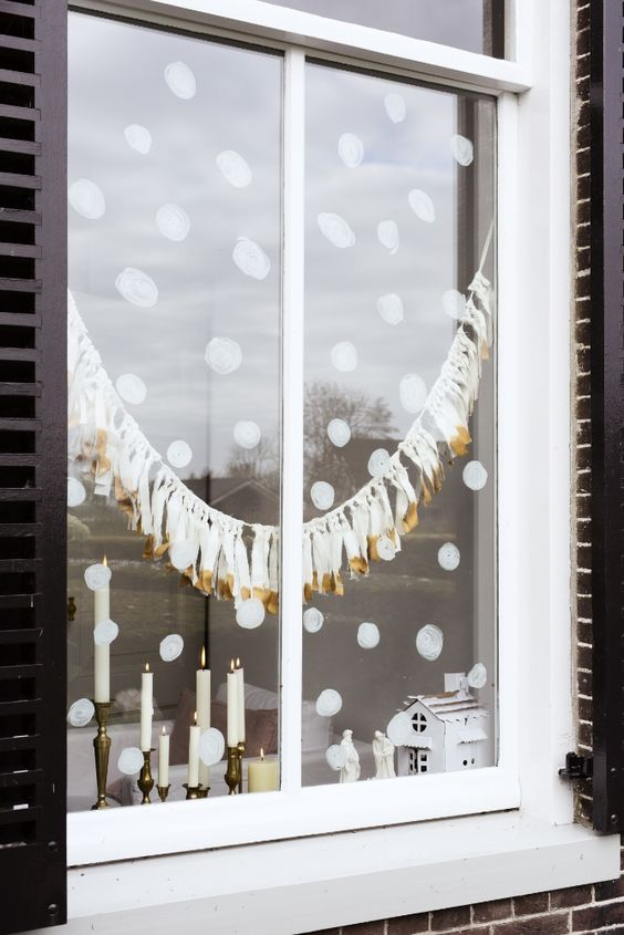 painted snow and white and gold tassel garland