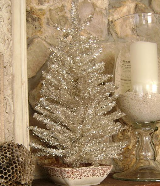 small silver tinsel tree in a bowl for vintage decor