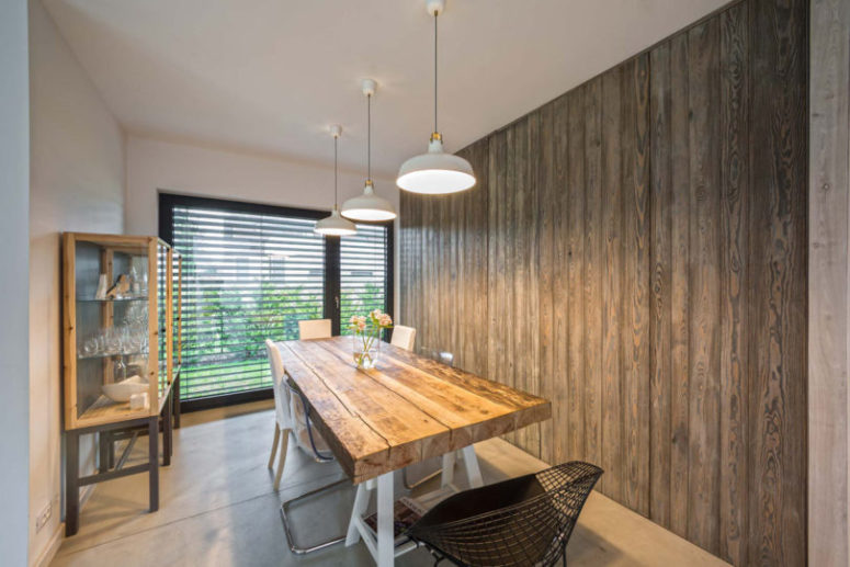 The dining zone features a lot of reclaimed wood and modern touches