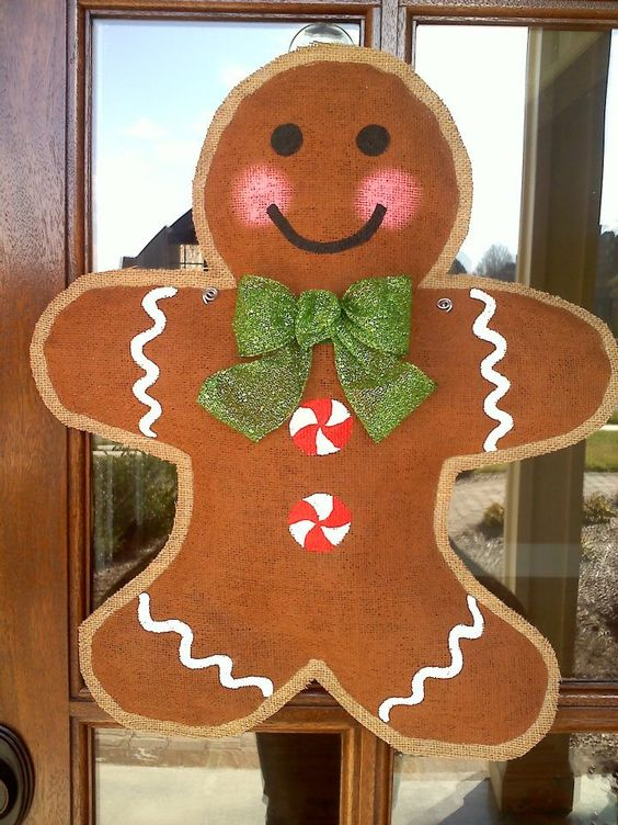burlap gingerbread hanger with a glitter bow screams Christmas
