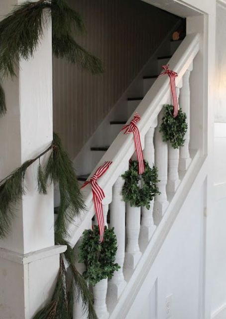 eucalyptus wreaths with striped ribbon and a fir garland