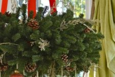 06 lush evergreen wreath with red ribbon and red and gold ornaments