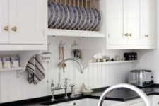 06 simple white beadboard backsplash contrasts with a black countertop