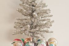 06 vintage Christmas display with colorful ornaments and a tinsel tree