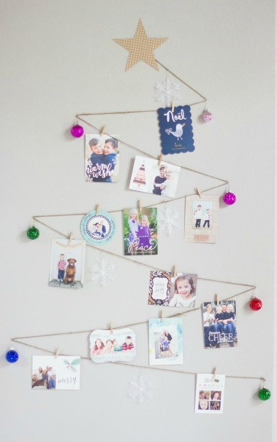 zigzag shaped Christmas tree with ornaments and photos