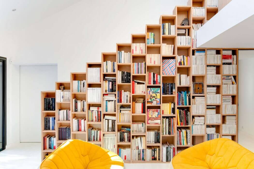 A bookshelf instead of a railing is a brilliant idea to divide spaces
