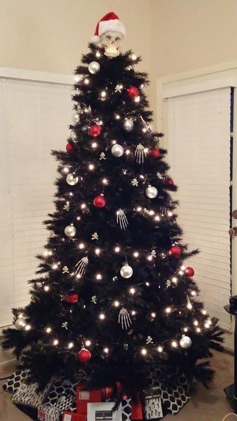 Nightmare before Christmas inspired black tree with lights, red and silver ornaments and skeleton hands