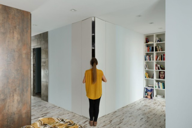 The storage is hidden behind sleek white panels to keep the space decluttered