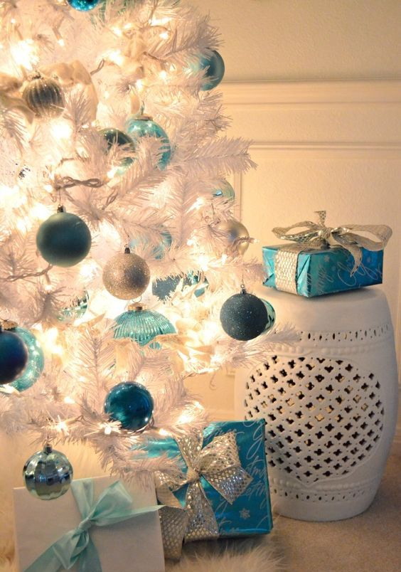 blue light blue silver ornaments on a white christmas tree - White Christmas Tree With Blue And Silver Decorations