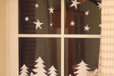 07 fir trees and stars from paper attached to the window