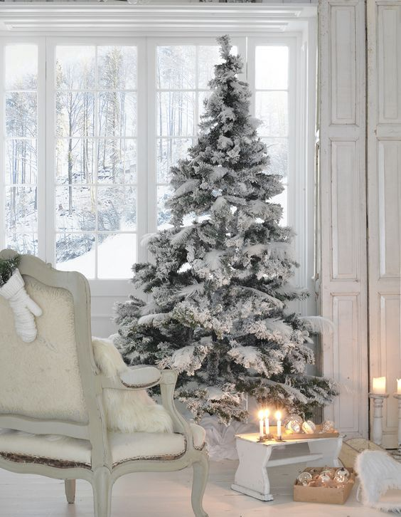 flocked tree with no decor is ideal for a white or neutral interior - Decorated Flocked Christmas Trees