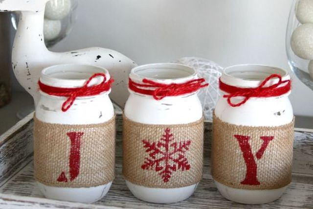 red and white mason jar candle lanterns with printed burlap