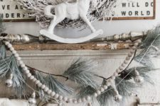 07 shabby chic mantel in off-white, a snowy wreath, garland and logs