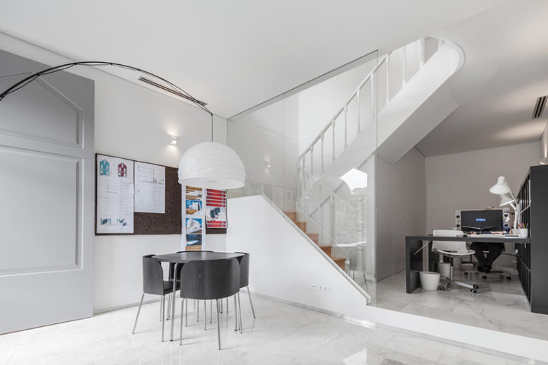 the ground floor is designed as an office space for working, and here you can also see lots of white