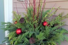 07 winter container with fresh evergreens, red branches and ornaments