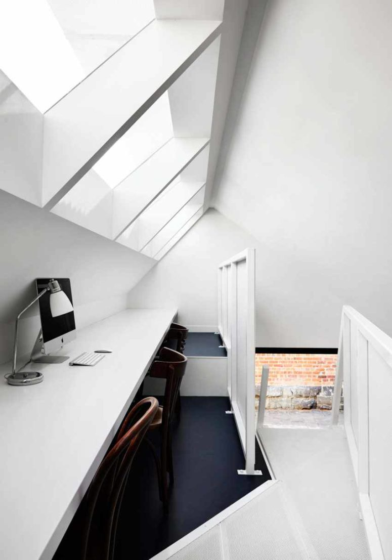 A small attic workspace is above the kitchen, and here you won't see any bold shades