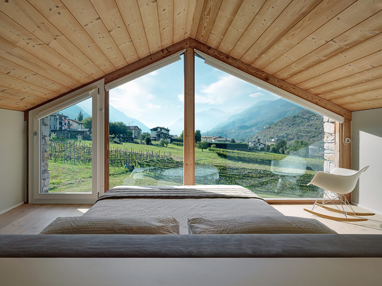 Look at this picturesque landscape, and the large window fills the bedroom with light