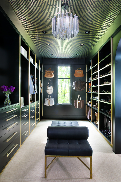 The closet is done in the same stylish black and gold colors, which scream the Roaring 20s