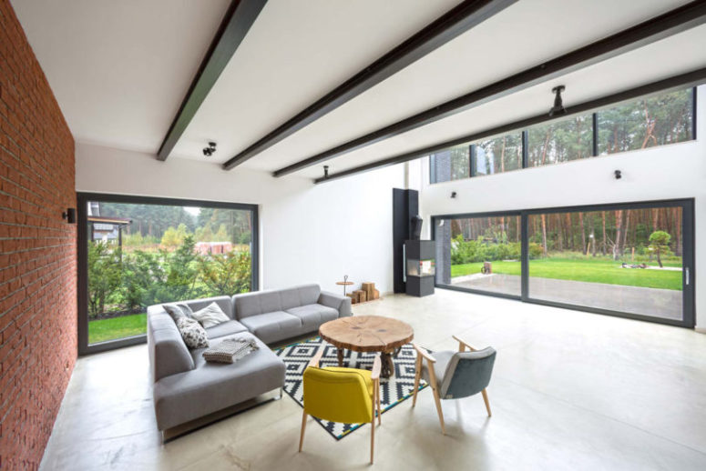 The living room is opened to outdoors and offer many relaxing views