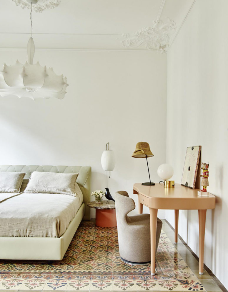 The master bedroom is refined and chic, done in ivory and peach colors, with upholstered furniture