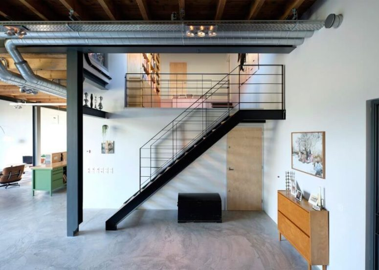The stairs are industrial, and there are a lot of exposed pipes everywhere that bring that edgy industrial touch