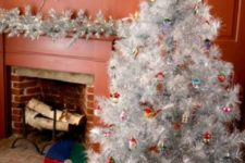 08 a silver tree decorated with colorful vintage ornaments, a silver and wreath with lights