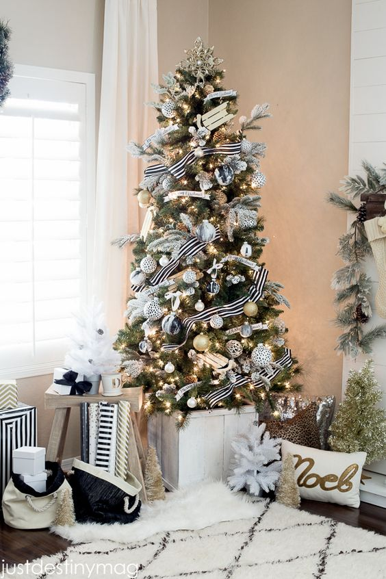 chic black and white Christmas tree decor with silver touches for a sparkle