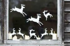 08 cut out reindeer from paper and attach them to the window creating your own look