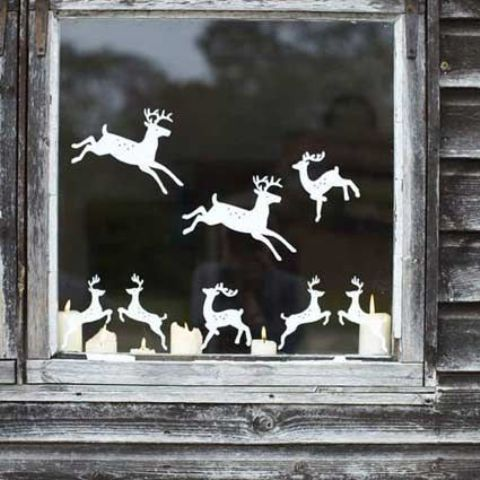 cut out reindeer from paper and attach them to the window creating your own look