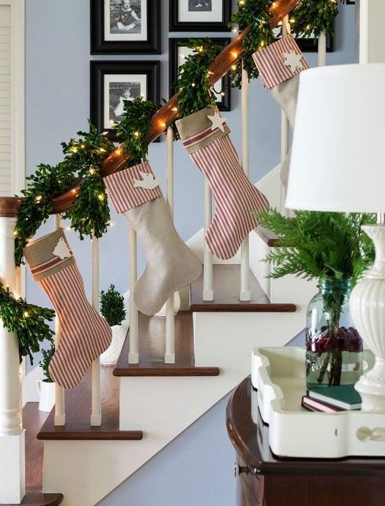 evergreen garland that wraps the banister and striped stockings