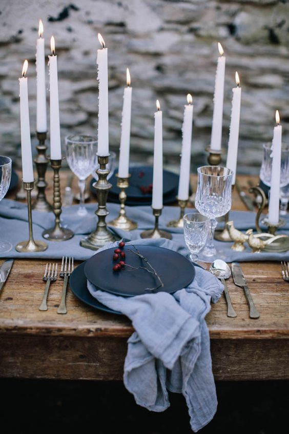 moody winter tablescape in grey and black, gilded candle holder add a refined touch