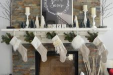 08 neutral stockings with evergreens, small trees and fluffy pillows
