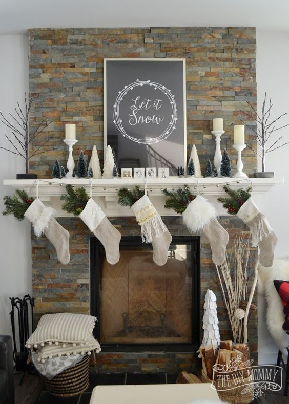 neutral stockings with evergreens, small trees and fluffy pillows
