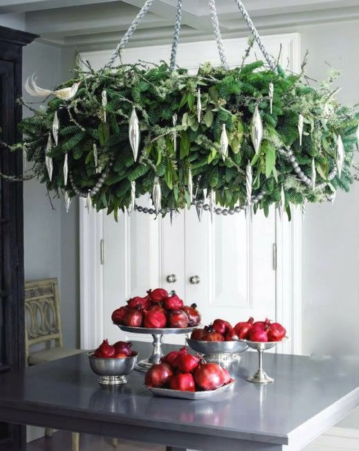 oversized green chandelier and silver ornaments will make a statement