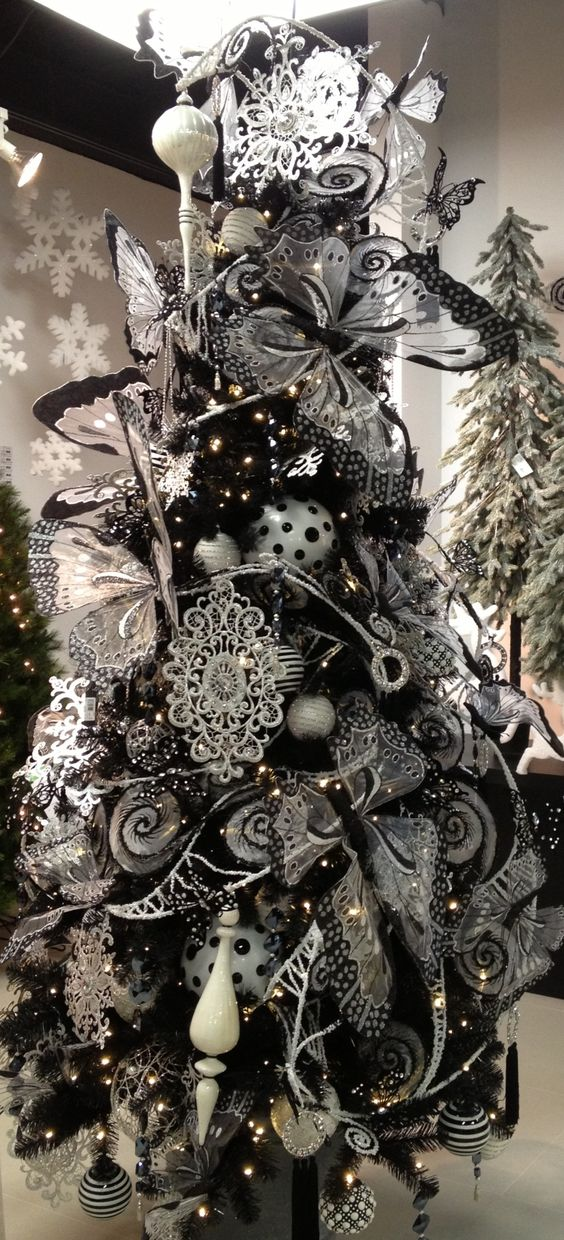 the whole tree heavily covered with romantic black and white ornaments - Black And Silver Christmas Tree