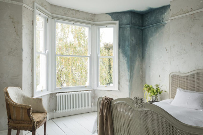The bedroom is shabby and decadent, there's a touch of patina on one of the walls