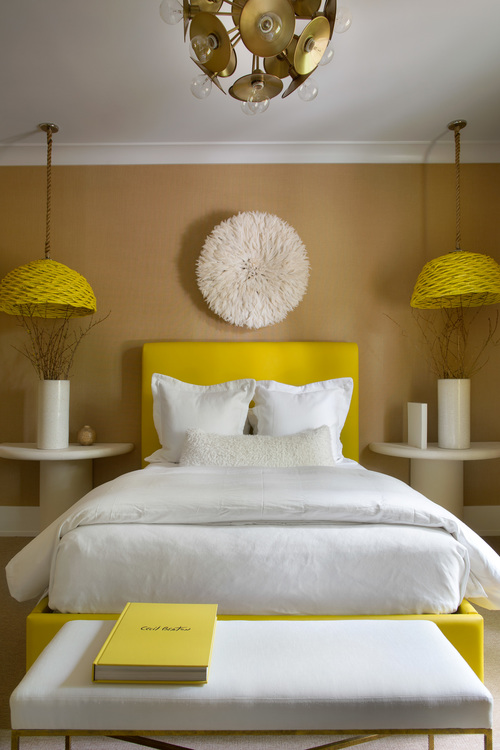 The guest bedroom is popping with yellow color, the room is neutral, though these sunny yellow touches cheer it up