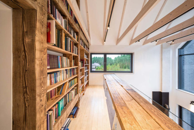 There's a library area on the upper floor, with large bookcases and a simple wooden bench